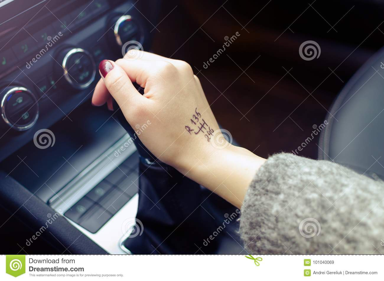 Woman switching manual transmission with the tip