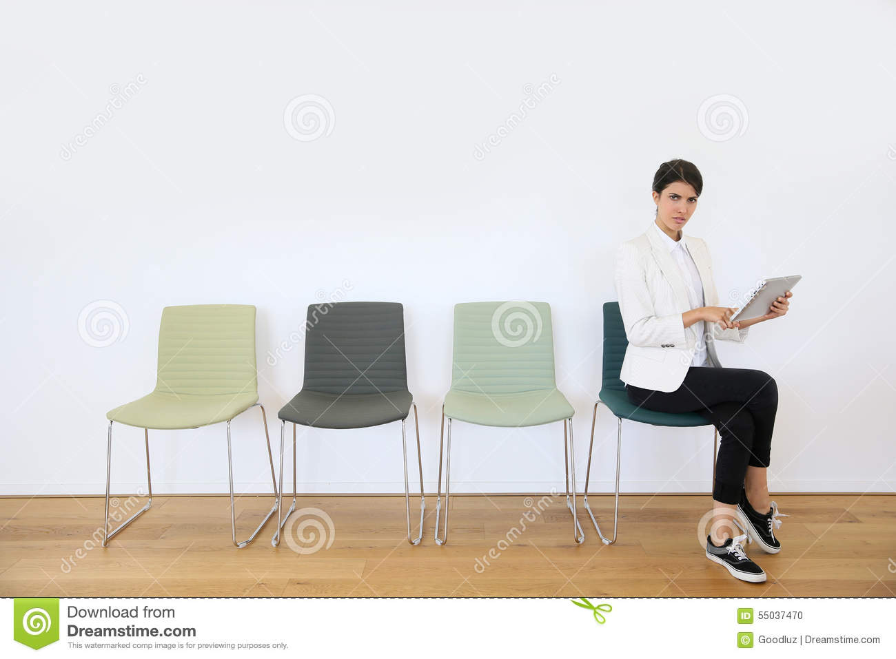 Woman with tablet in waiting room