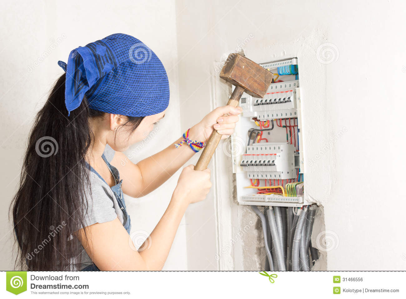 woman taking aim electrical fuse box large wooden mallet effort to solve her supply problems 31466556 woman taking aim at an electrical fuse box royalty free stock how to open a home fuse box at reclaimingppi.co