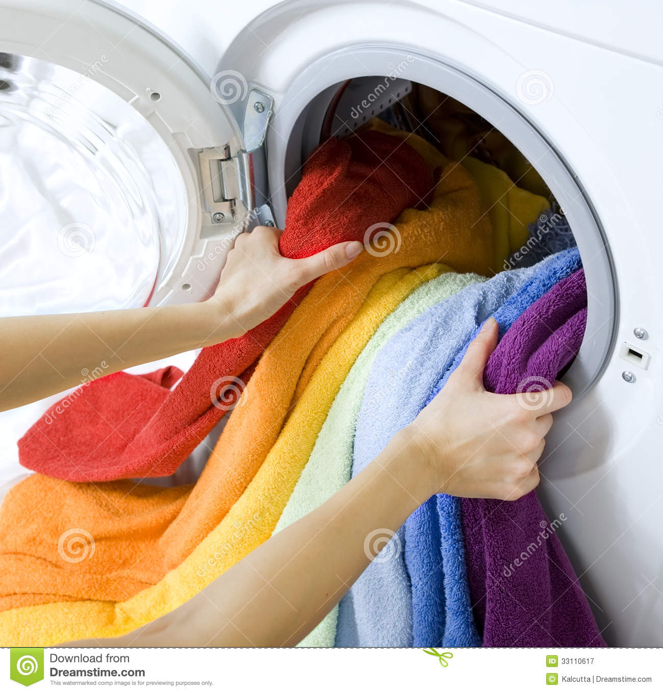 Clothes Being Washed ~ Woman taking clothes from washing machine stock image