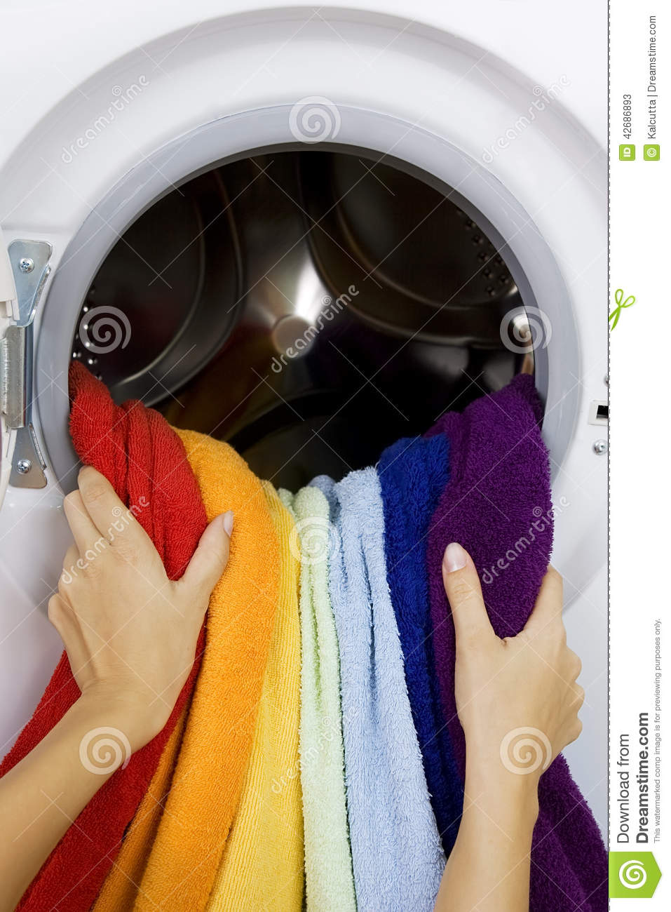 Woman taking color clothes from washing machine stock photo image 42686893 - Protect clothes colors washing ...