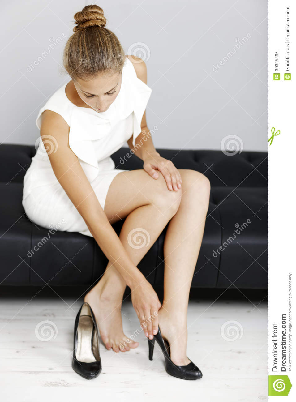woman taking her shoes off stock photo - image: 39395366