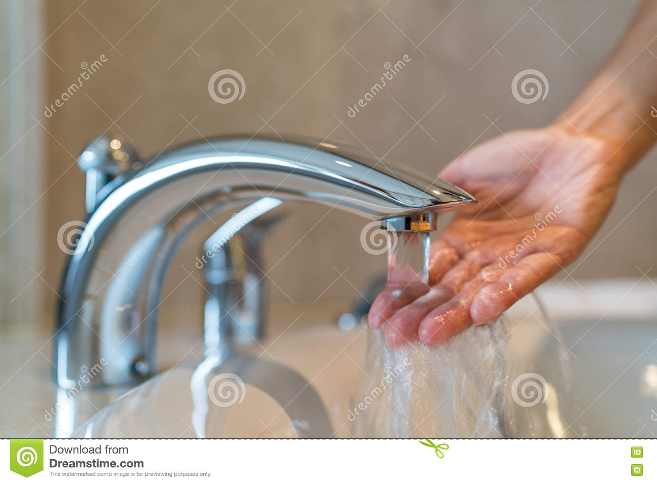 Woman taking home bath checking water temperature