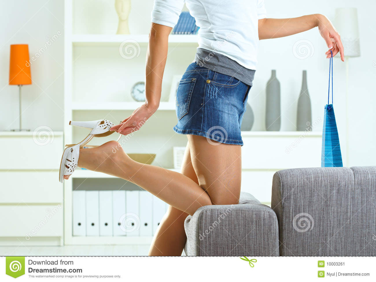 Woman taking off high heel shoe