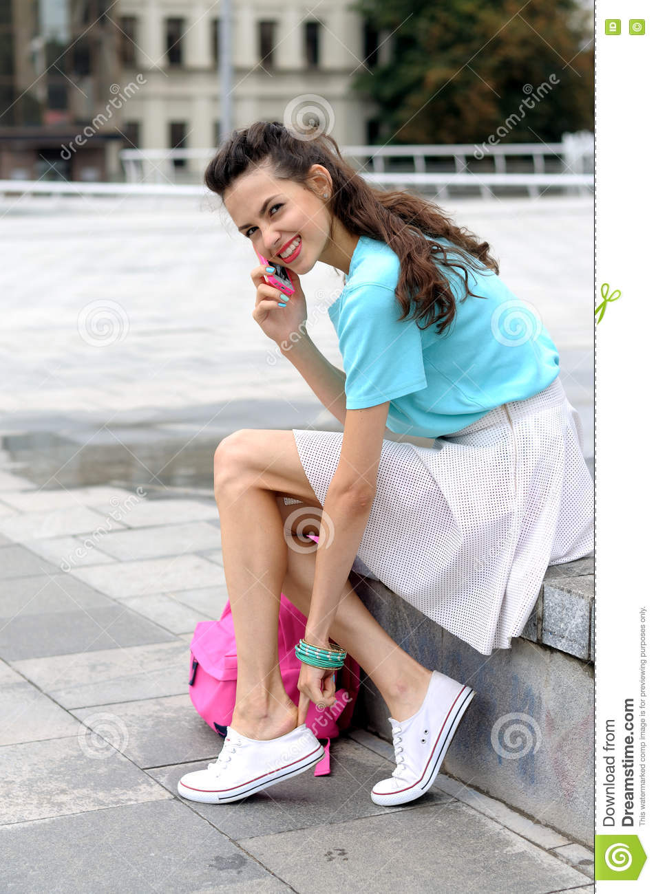 https://thumbs.dreamstime.com/z/woman-talking-cell-phone-putting-shoes-sitting-stairs-outdoors-76559685.jpg