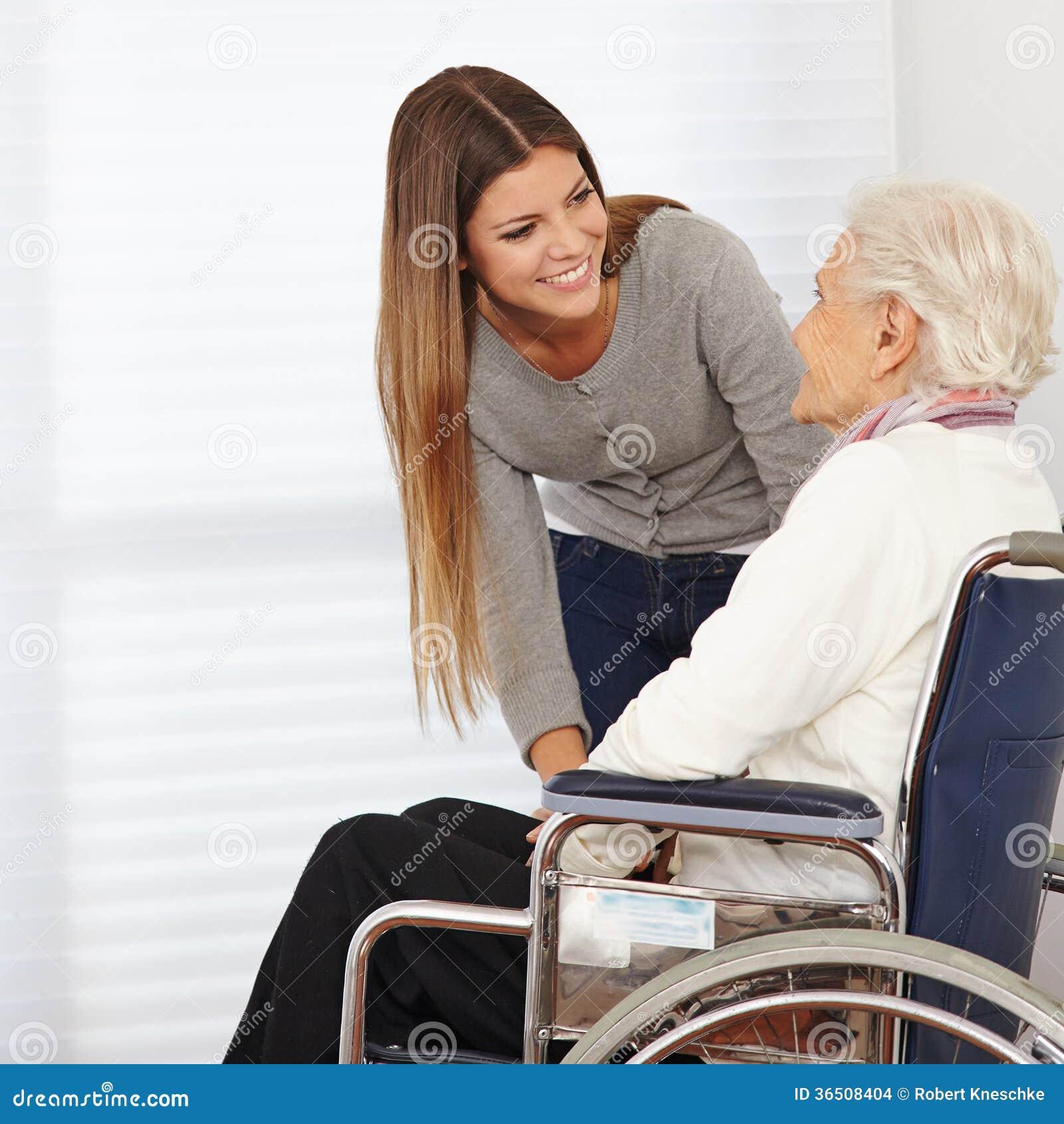 Woman talking to senior citizen