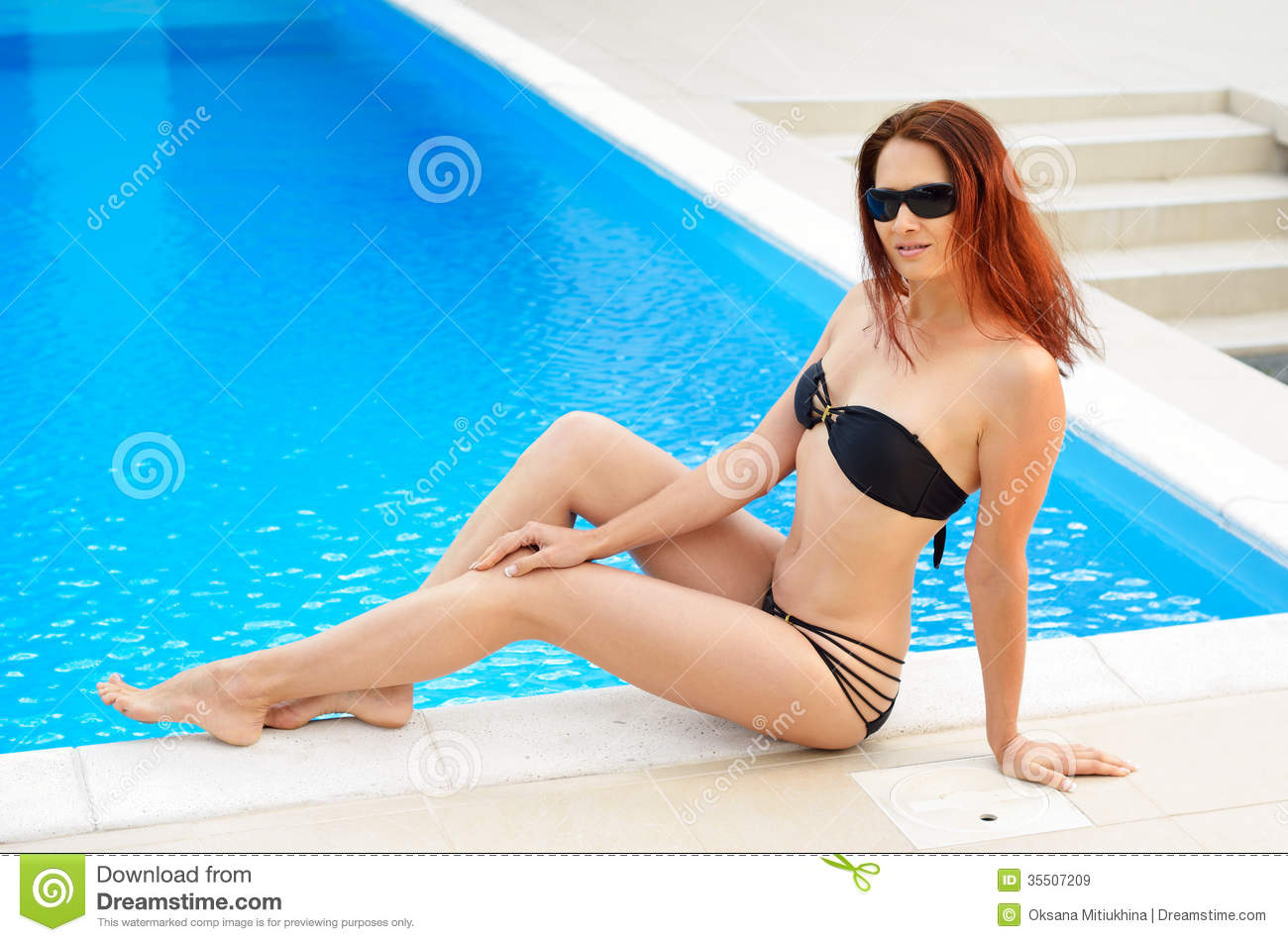 Woman Tanning Near The Home Pool Royalty Free Stock Images