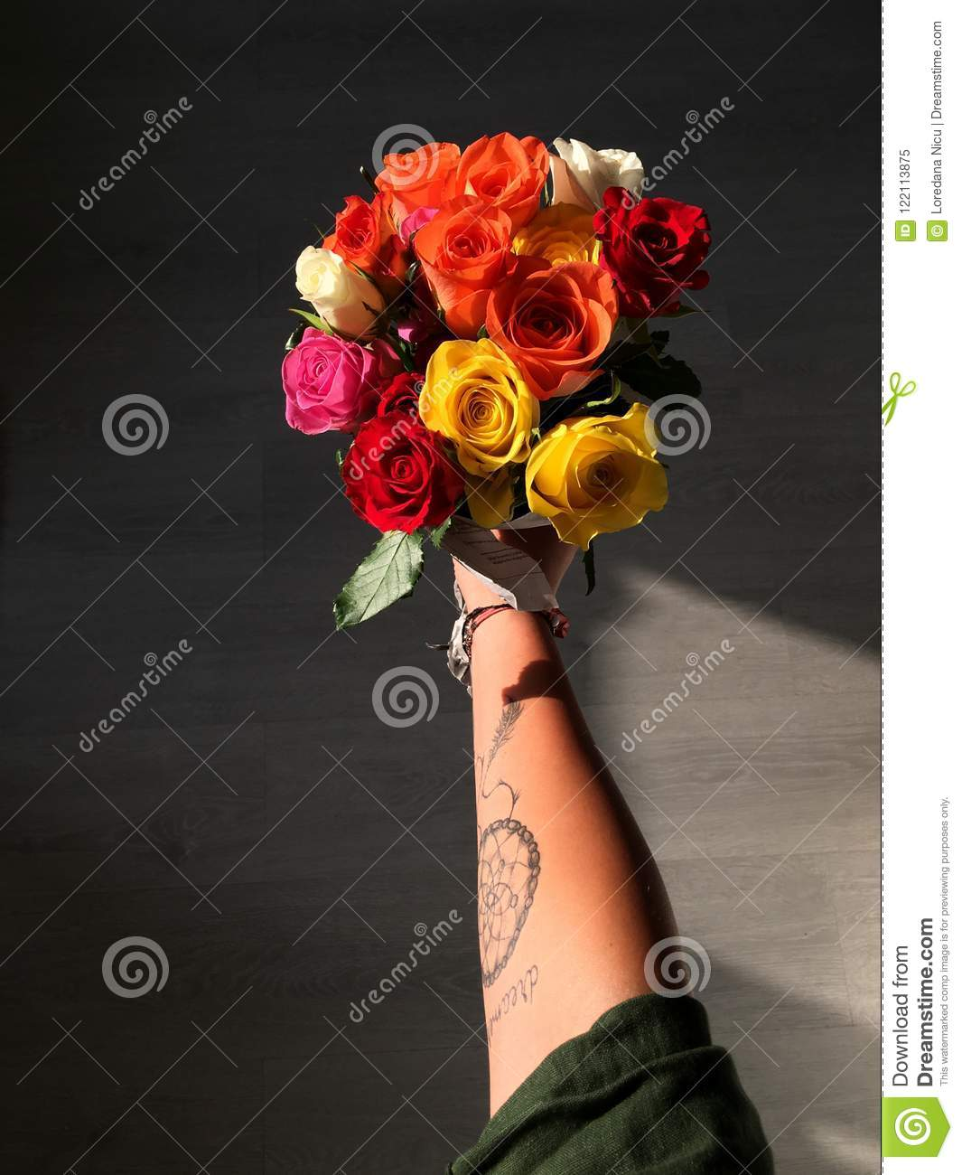 Hand With A Tattoo Holding Flowers Stock Image Image Of Interior Indoor 122113875