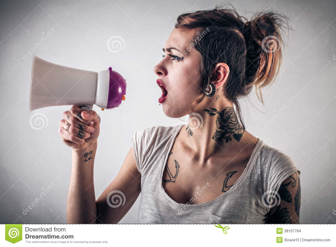Woman with tattoos using a megaphone stock images image for Woman with tattoos