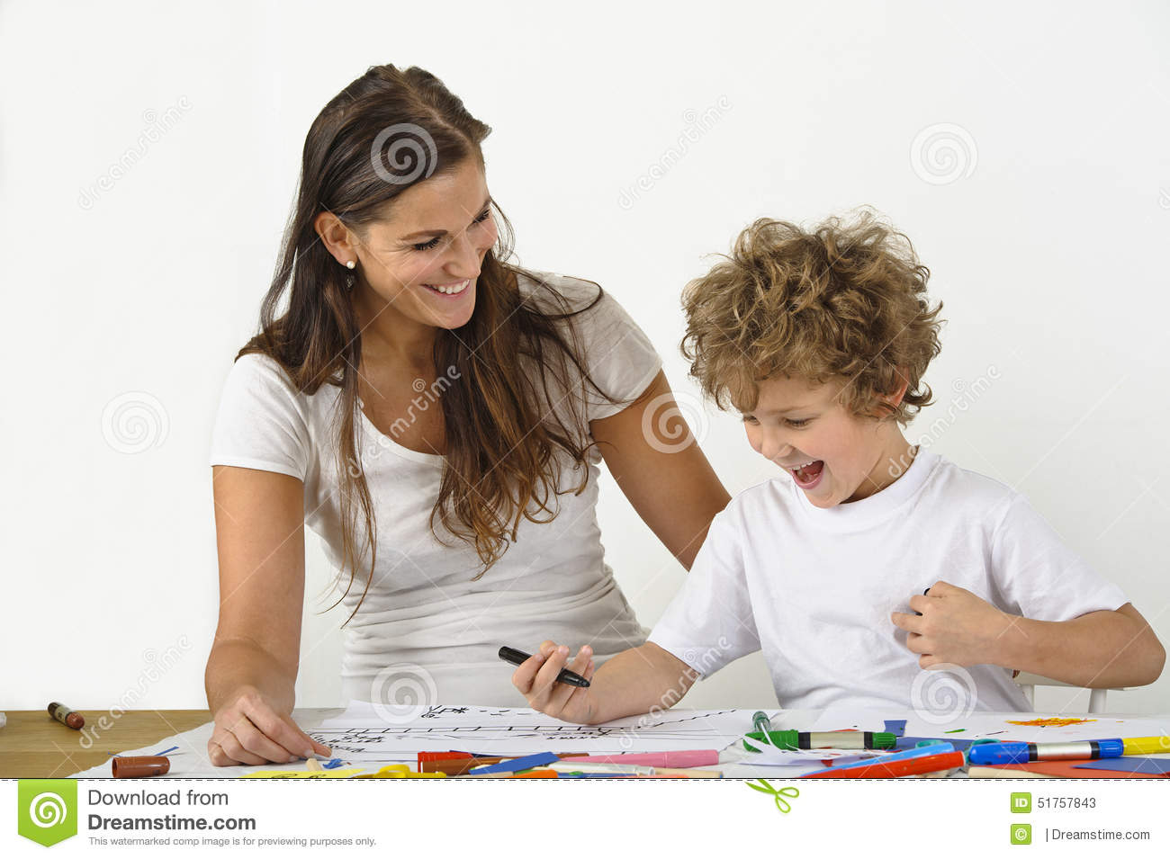 Woman teaches her child how to draw