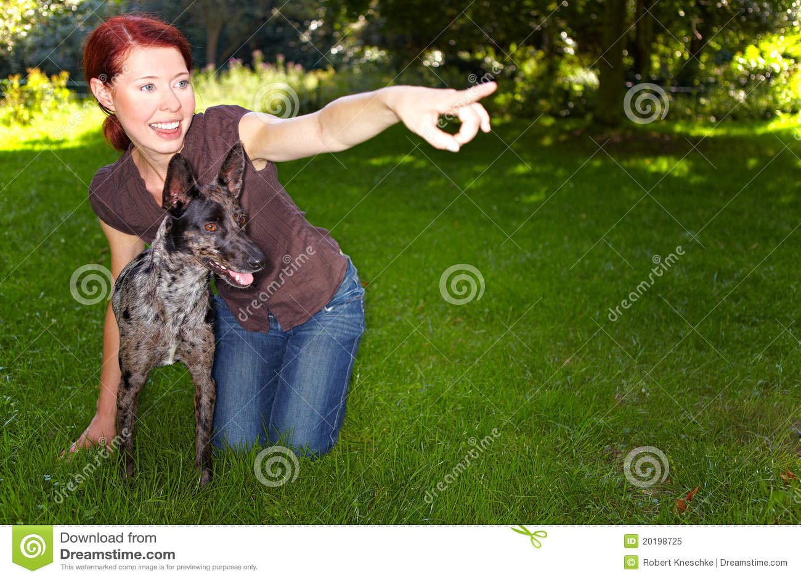Woman teaching dog to fetch