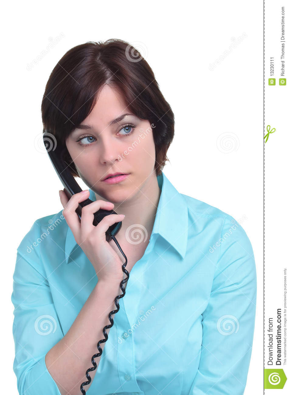 Woman on the telephone isolated on white