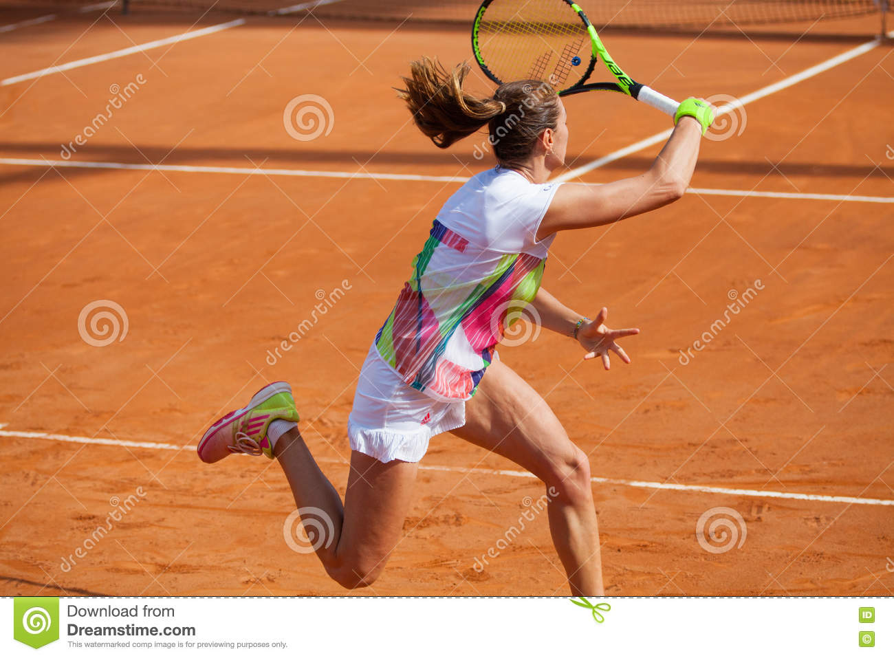 Woman tennis player in action. With racket in hand.
