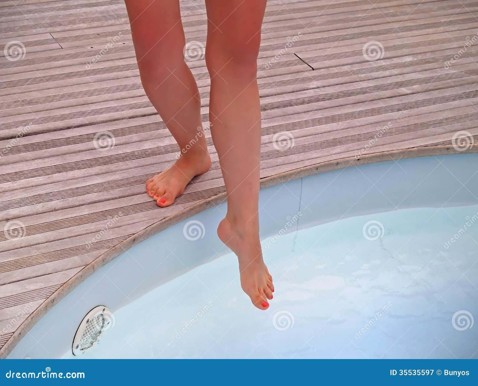 Woman Testing Swimming Pool Water Temperature Stock Image Image 35535597