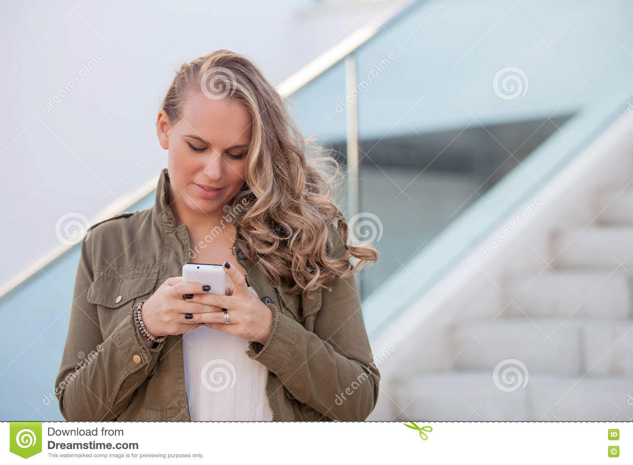 Woman texting on cell or mobile phone