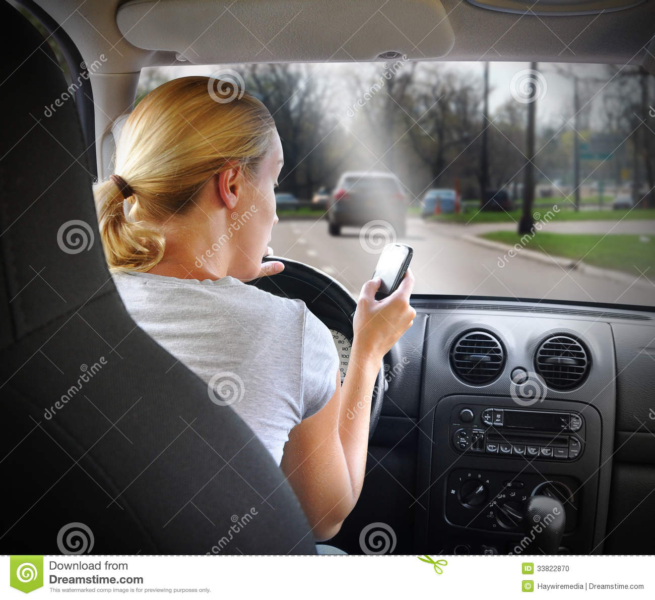 Woman Texting on Phone and Driving Car