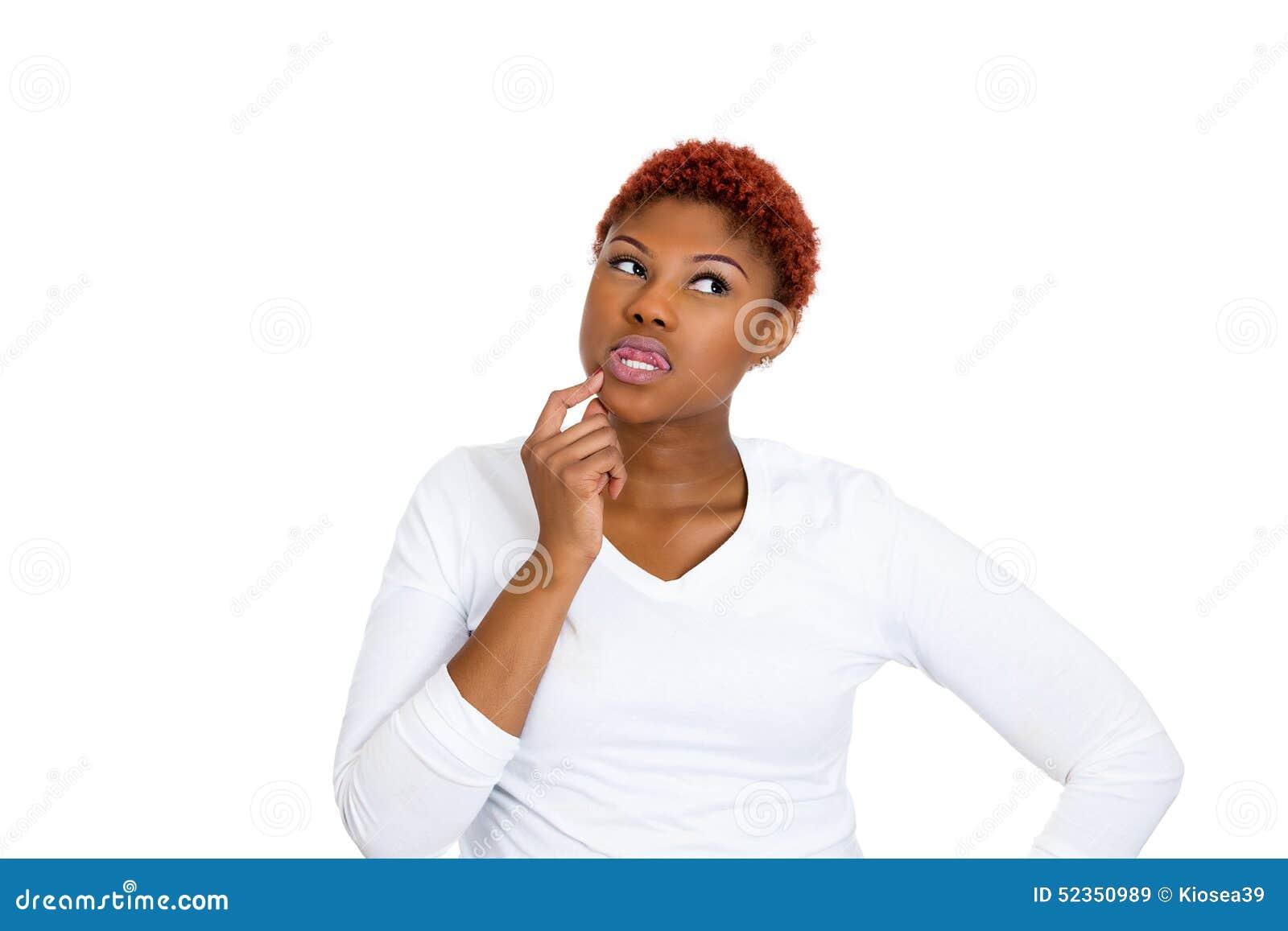 Woman thinking daydreaming something, plotting revenge