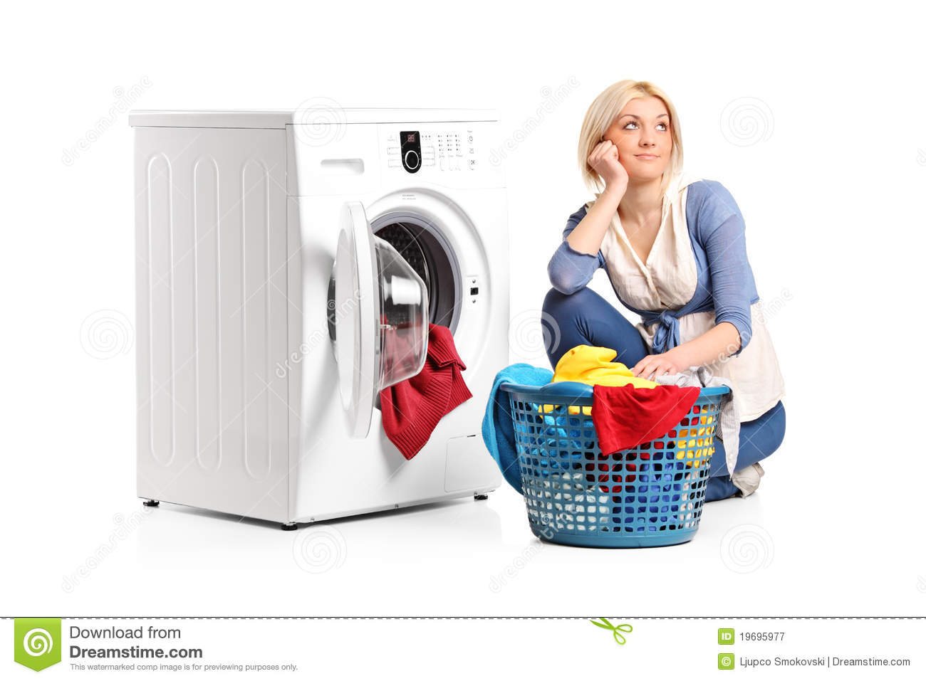 Woman in thoughts seated next to a washing machine