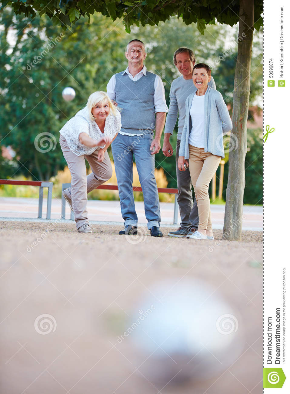 Woman Throwing Ball While Playing Boule Stock Photo