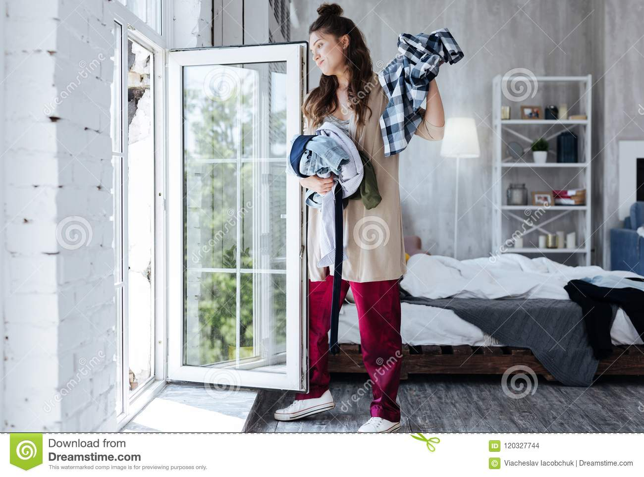 Woman throwing clothes of her ex husband from the window