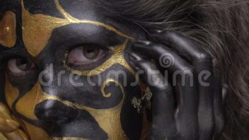 A Woman Touches A Gold Finger In Her Lip Body Art Slow Motion Stock Footage Video Of Style Dark 122515114