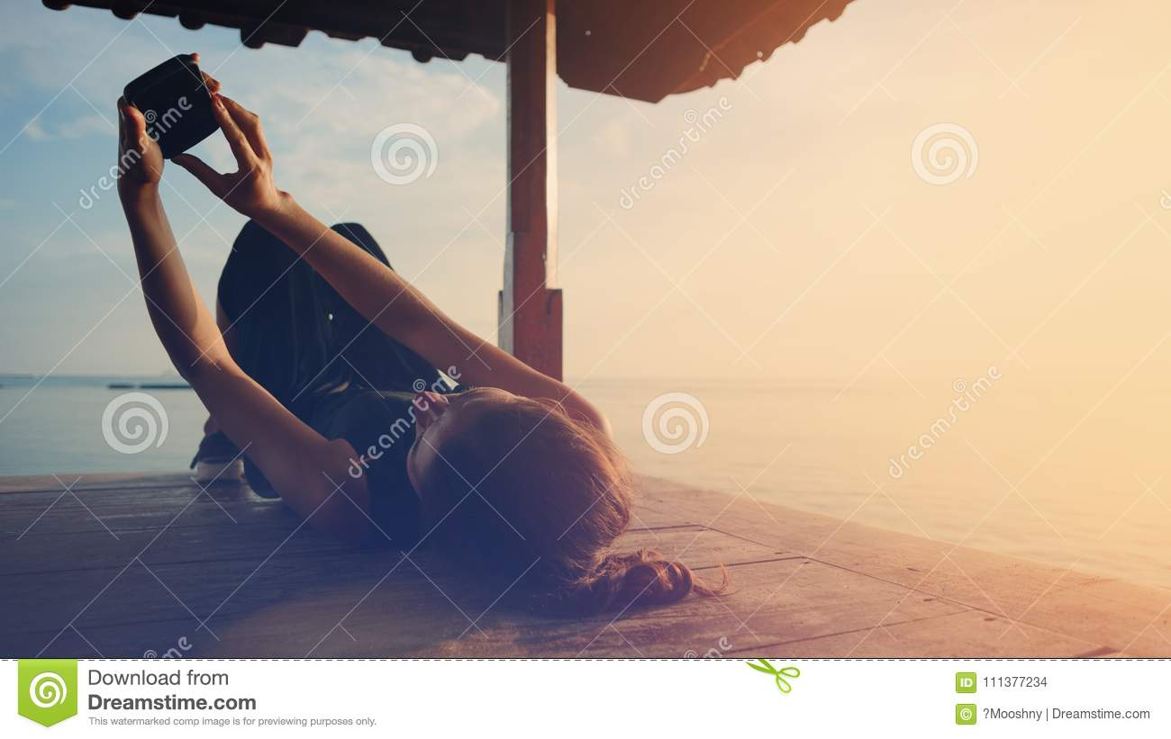 Woman Touching Mobile Phone And Resting Near Ocean, Sun ...