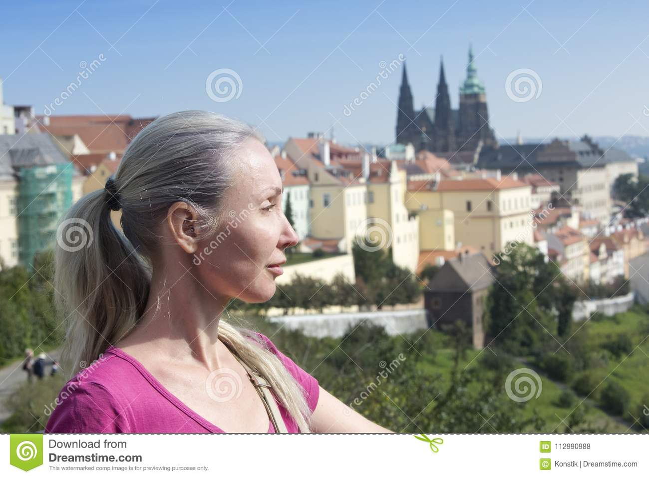 The woman the tourist on a beautiful background of the old city, Prague