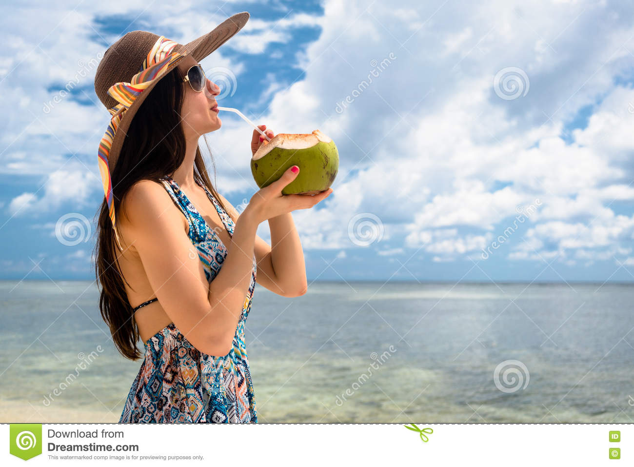 Woman Tourist Drinking Coconut Milk At Beach In Holidays