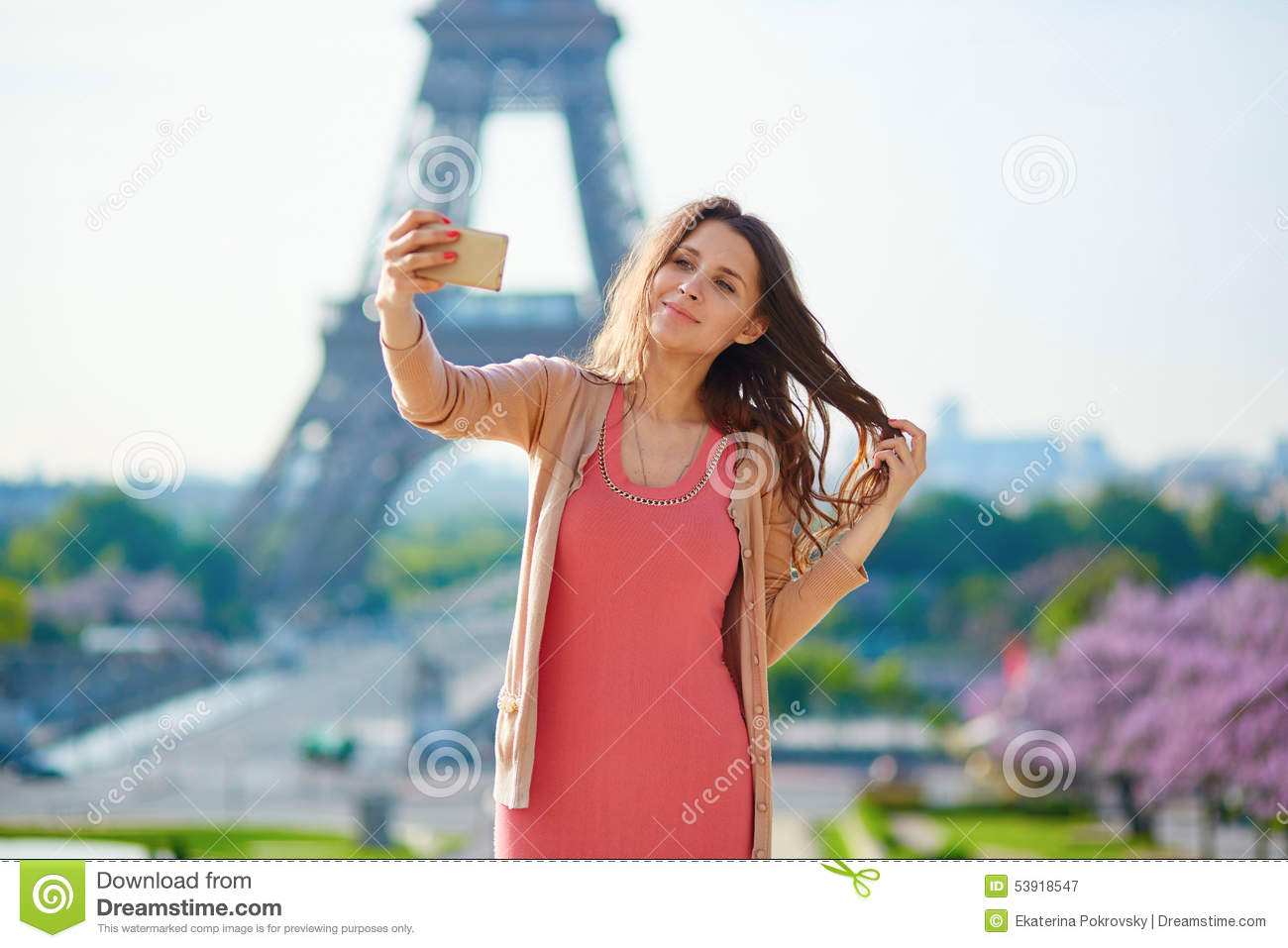 Woman tourist at eiffel tower making travel selfie stock photo image