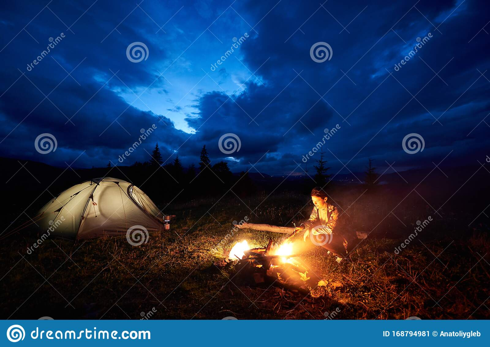 Woman Tourist Resting At Night Camping In Mountains Near ...