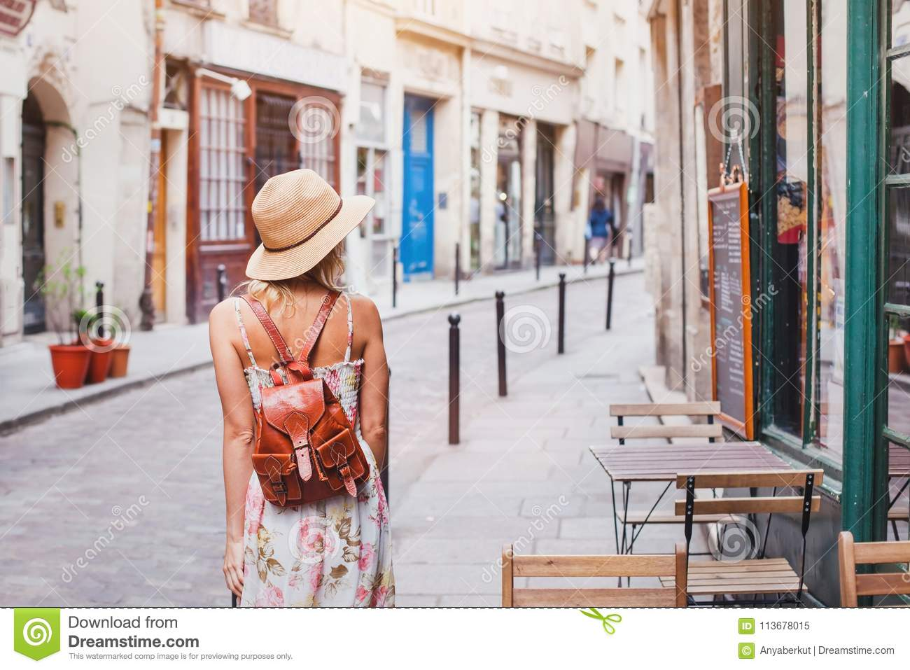 Woman tourist on the street, summer travel concept