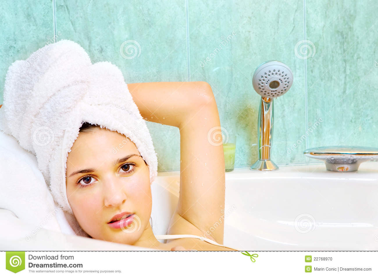 Woman With Towel On Head In The Bathtub Stock Photo