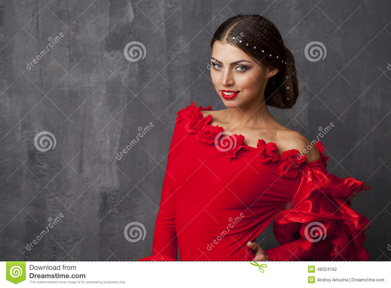 traditional spanish flamenco woman dancer in a red stock photo