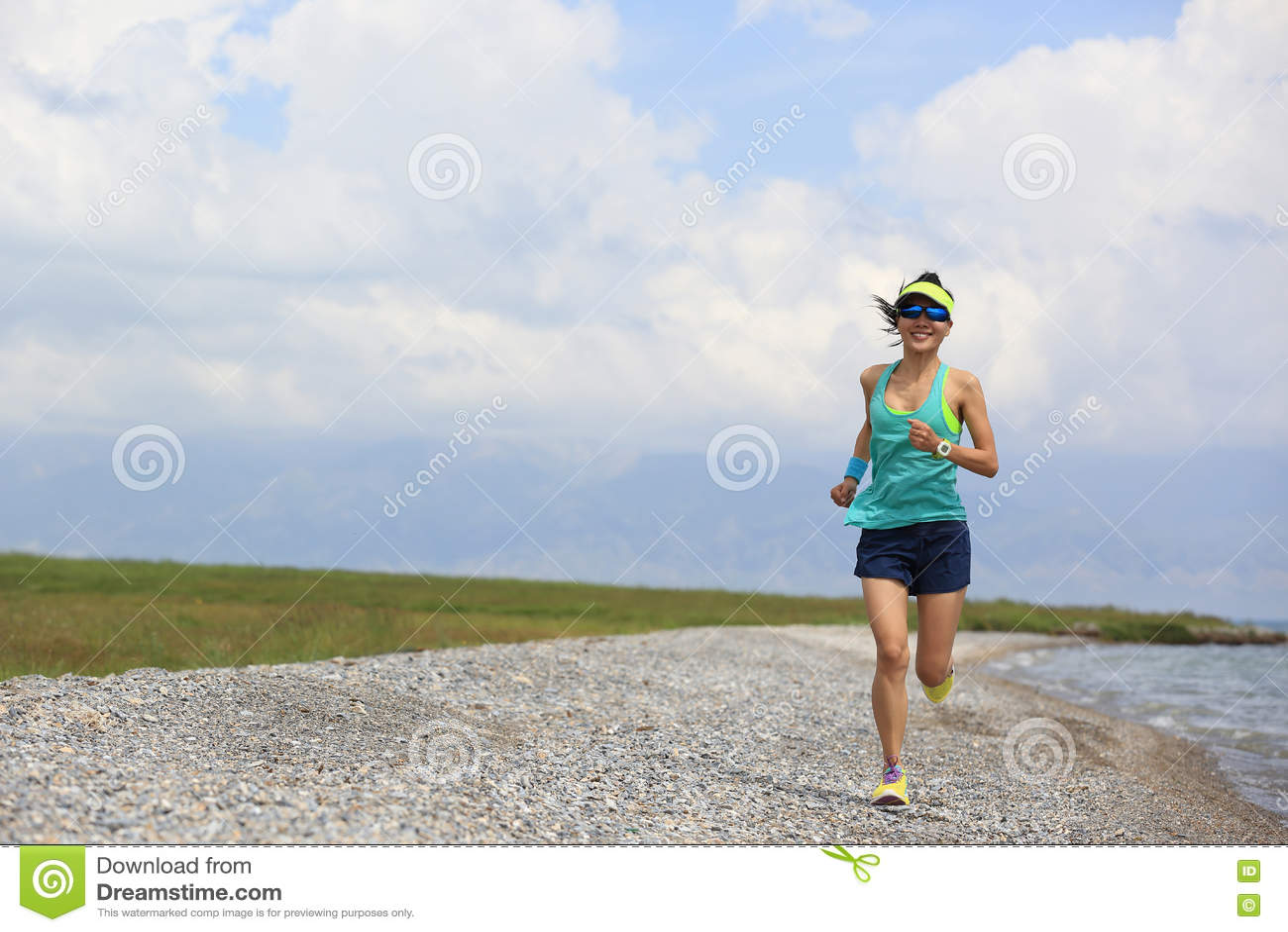 Woman trail runner running on beautiful trail