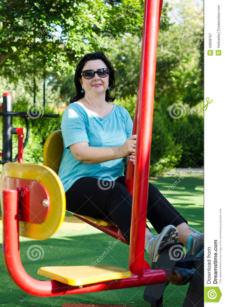 woman training on a leg press station outdoor stock image - image of