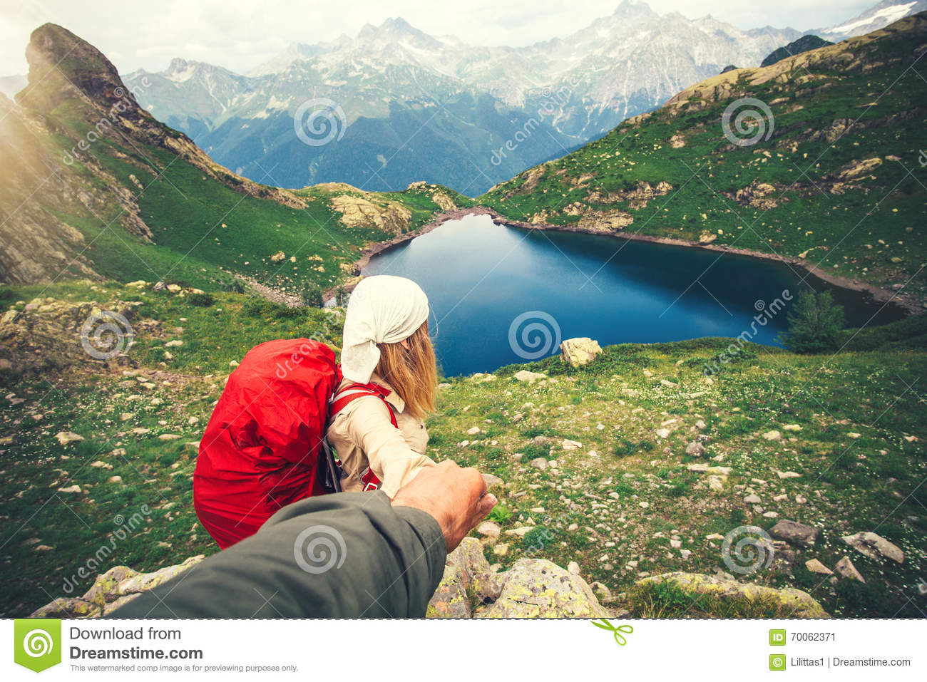 Woman Traveler with backpack holding Man hand following Travel hiking
