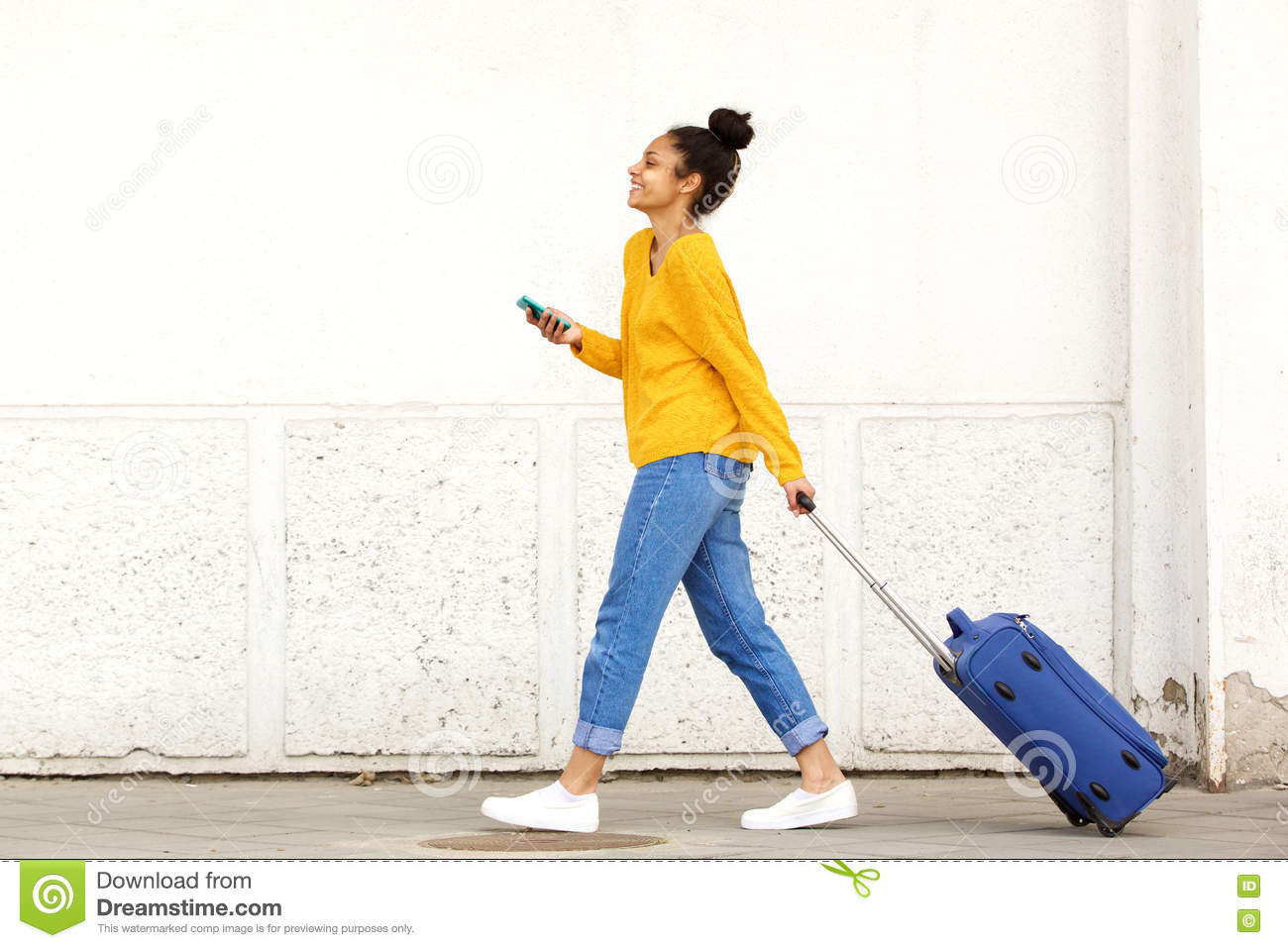 Woman traveler with luggage and mobile phone