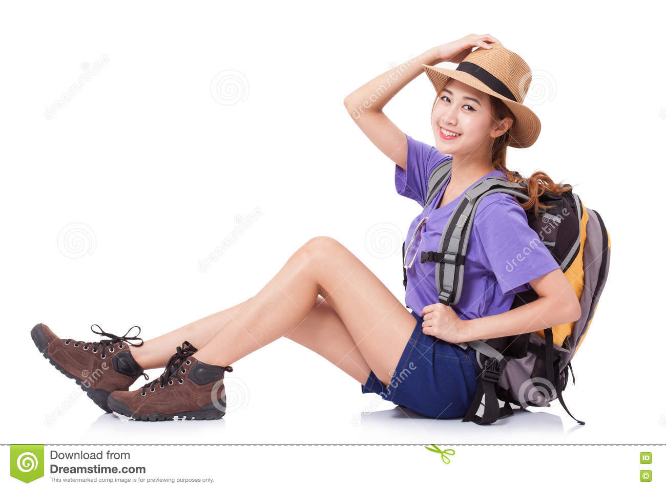 Woman traveler sitting on the floor with backpack