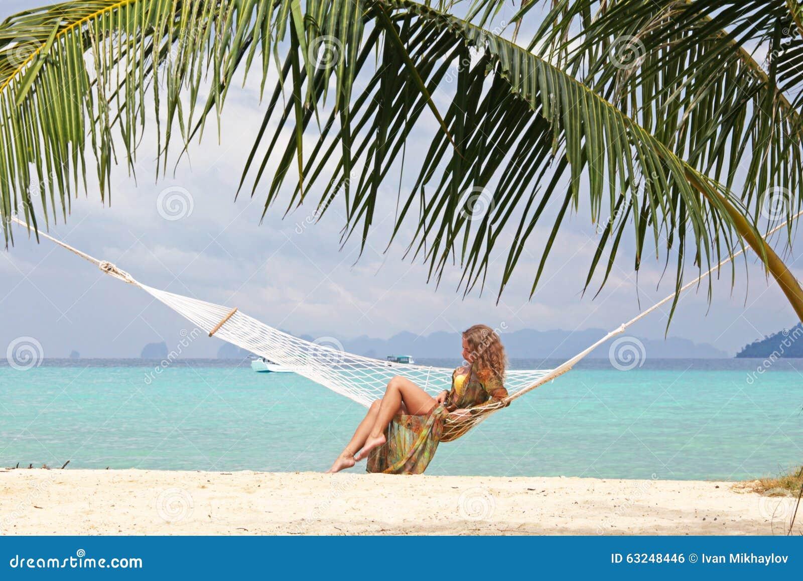 Palm Beach Tan Prices >> Woman on tropical beach stock photo. Image of hammock - 63248446
