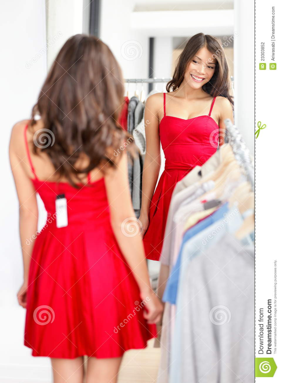 Woman trying red dress shopping for clothing. Beautiful happy smiling ...
