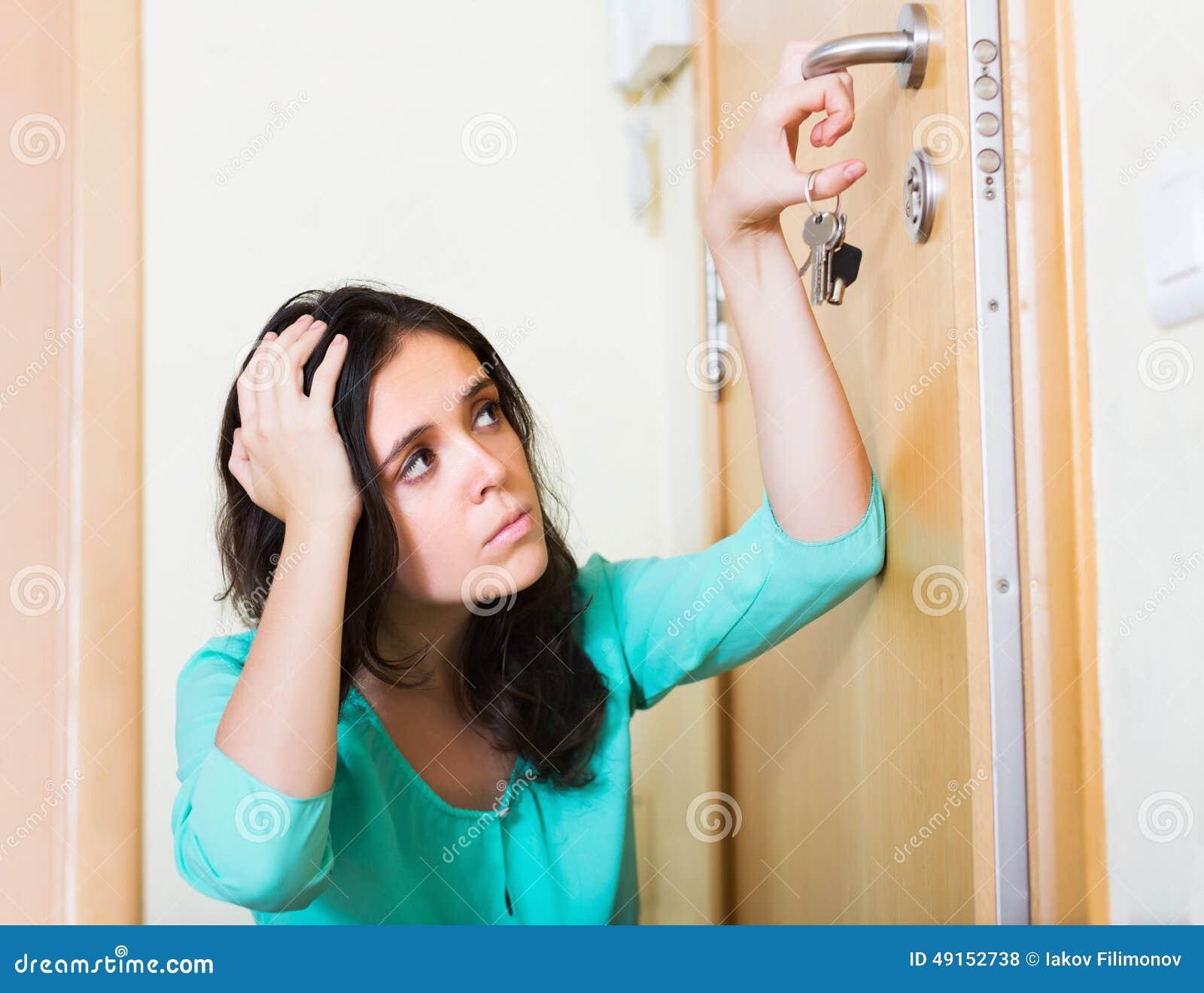 Woman trying to lock door