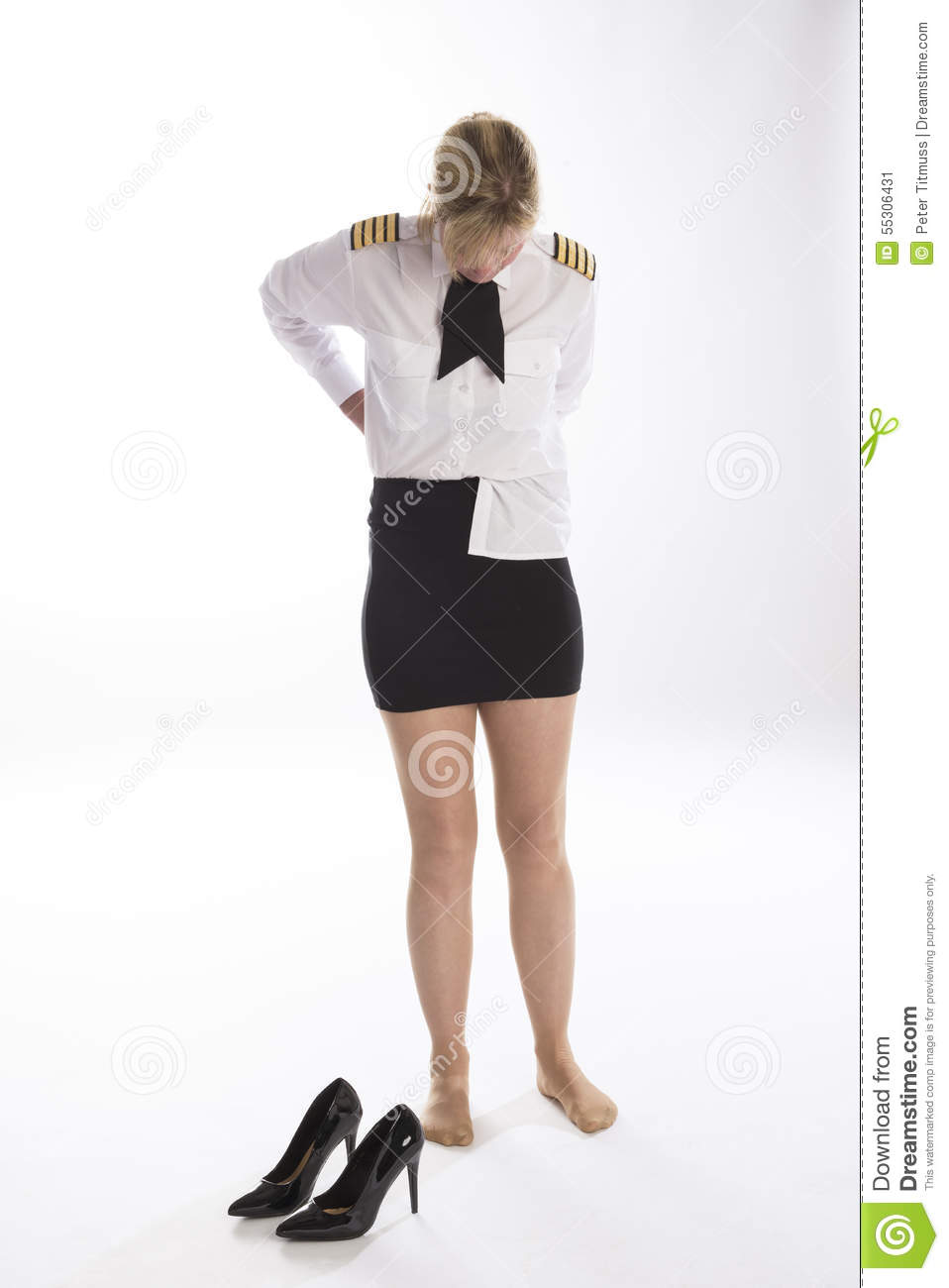 woman tucking in her shirt stock photo image 55306431