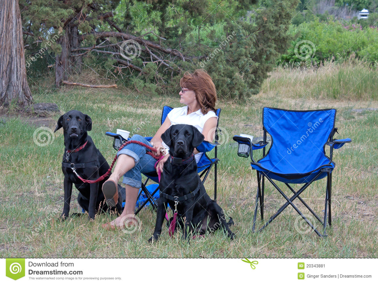 Woman With Two Black Dogs
