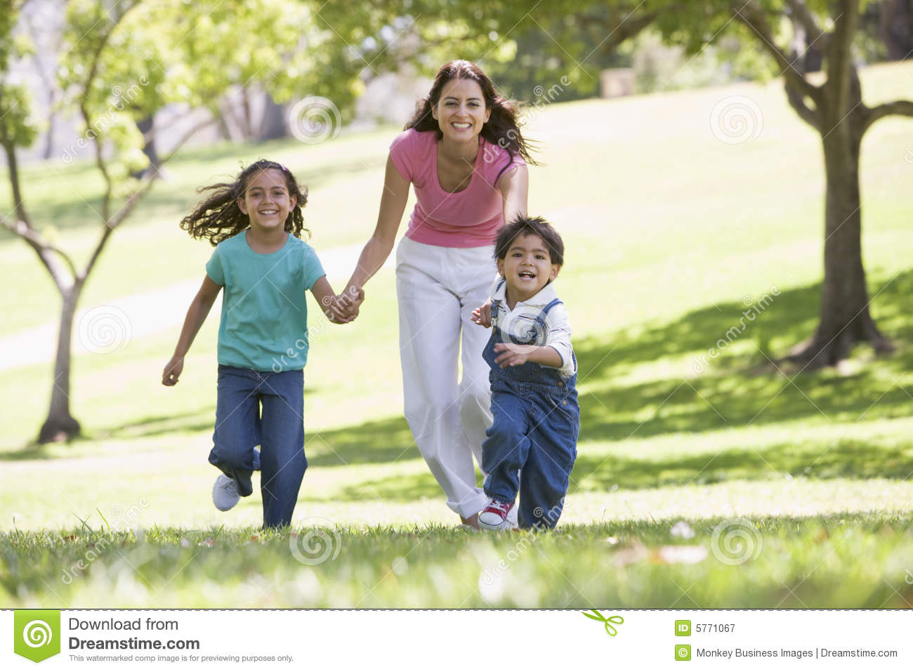 woman with two young children running smiling royalty free