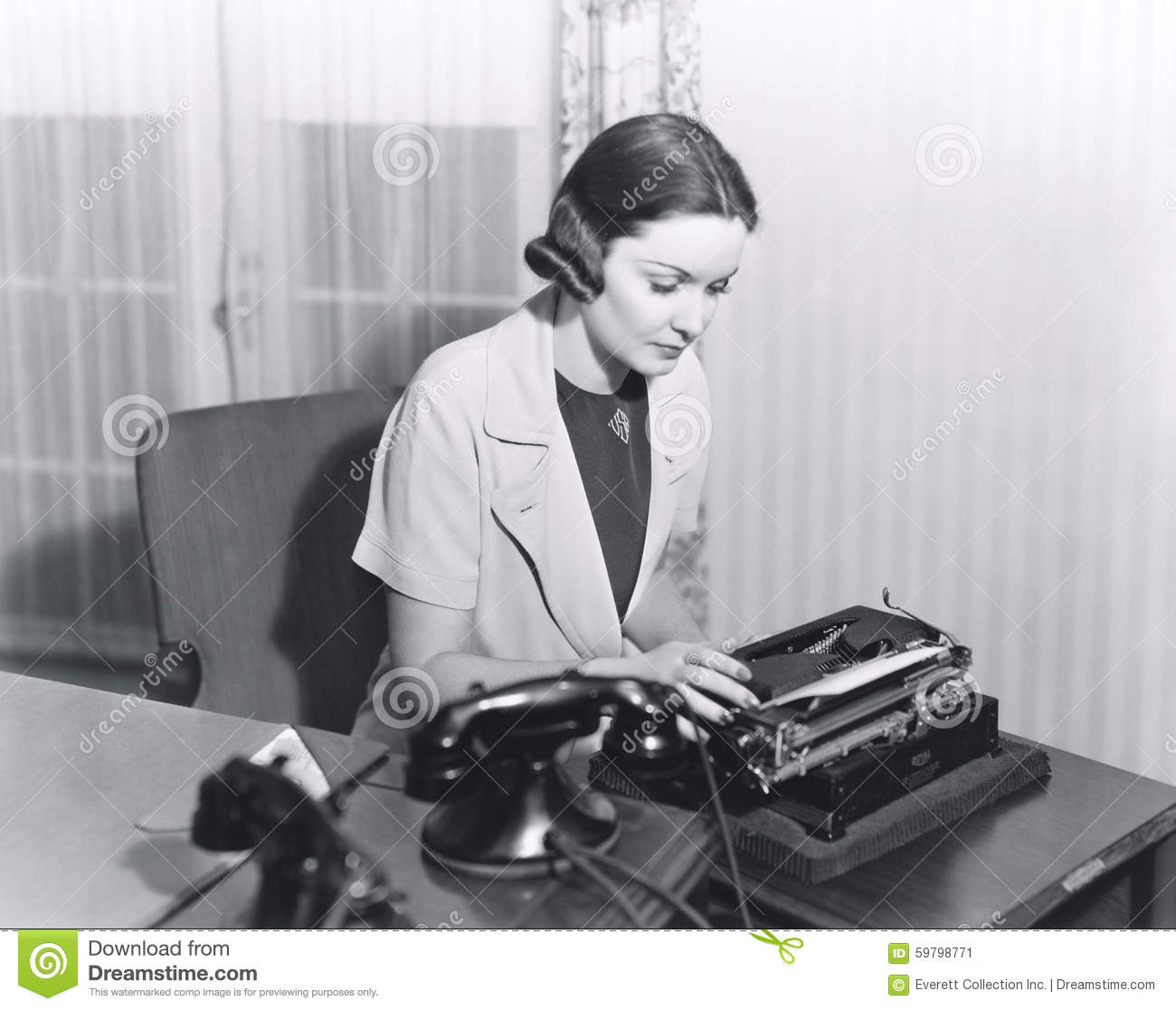 Woman typing a letter