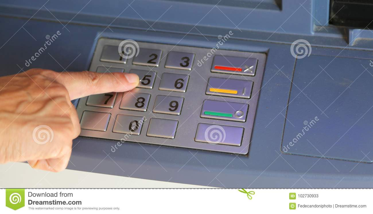 Woman Typing The Secret Code On The ATM Keyboard Stock Image