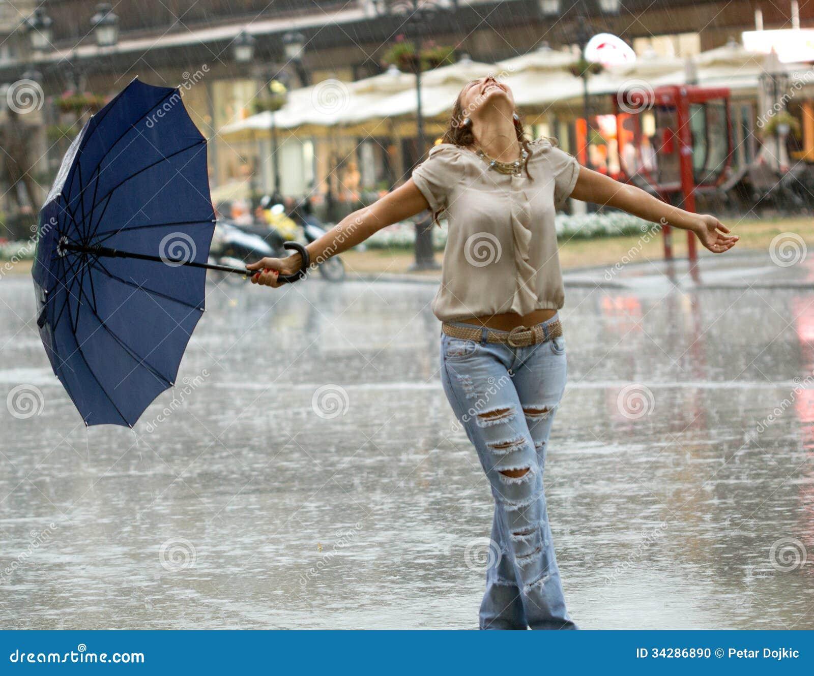 Happy Beautiful Woman Enjoying At Beach Stock Photo: Woman With Umbrella Enjoying In The Rain Stock Photo