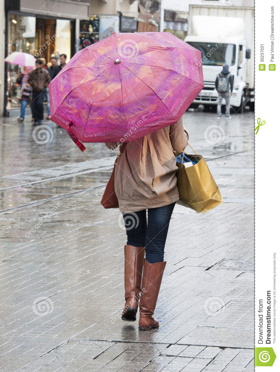 Woman With Umbrella Walking Down Street Stock Image ...