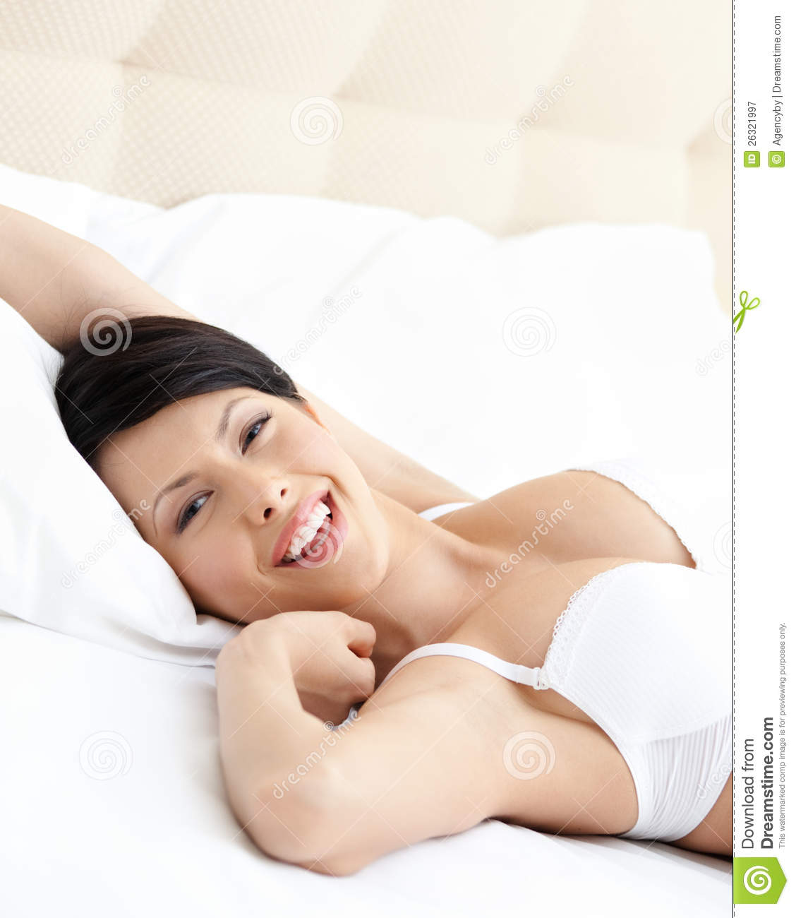 Woman in underwear is lying in the comfortable bed stock for Sexy bed photos