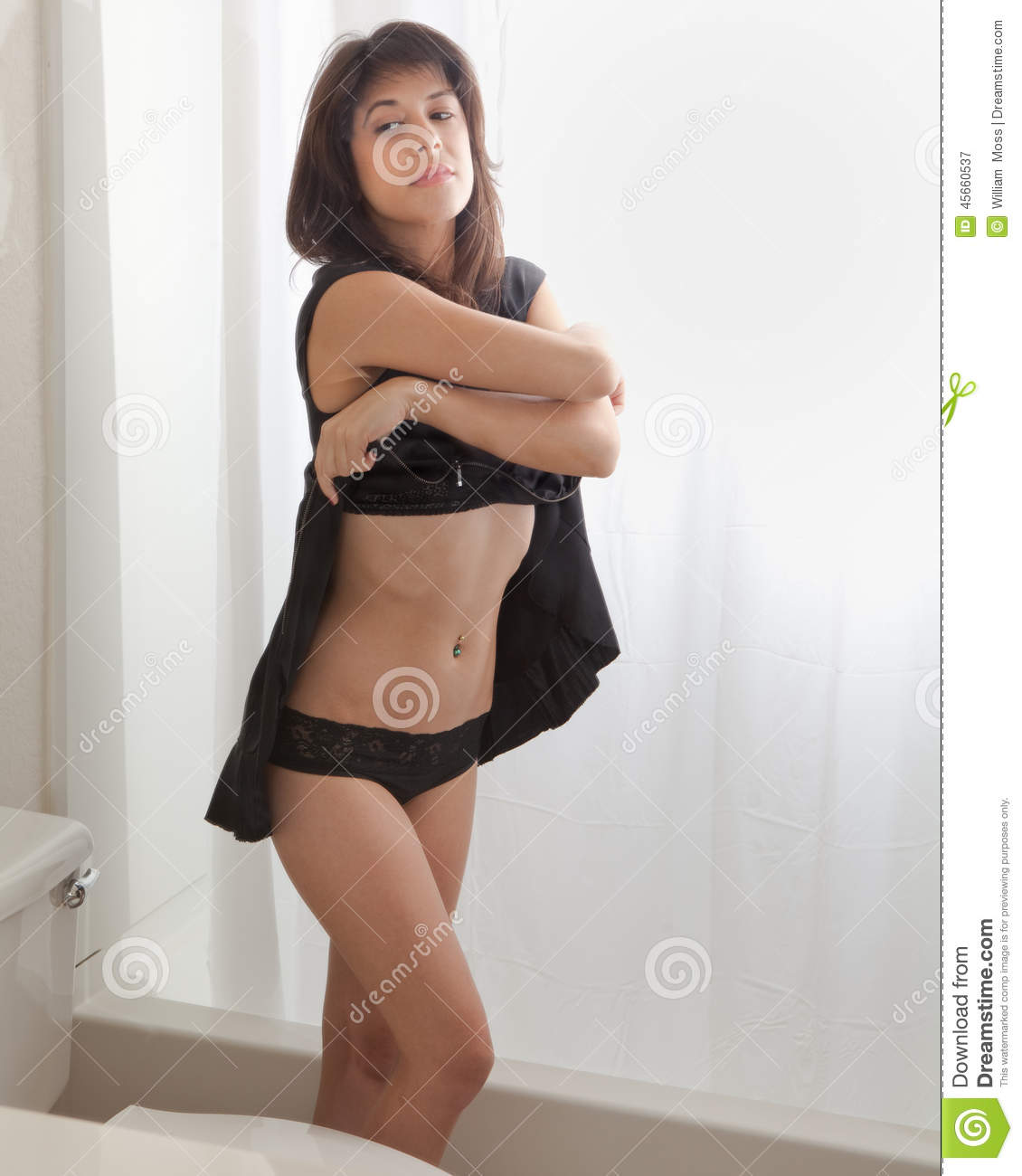 Woman Undressing In Bathroom Stock Photo - Image: 45660537